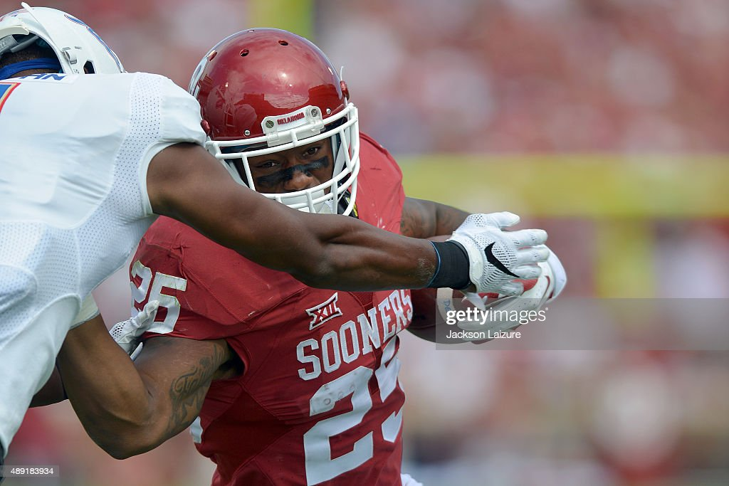 Running back Joe Mixon #25 of the Oklahoma Sooners fights for a touchdown against the Tulsa Golden Hurricane at Gaylord Family Memorial Stadium on September 19, 2015 in Norman, Oklahoma.