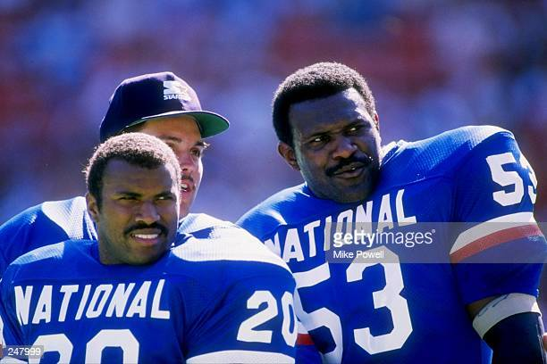 Running back Joe Morris kicker Sean Landeta and linebacker Harry Carson of the New York Giants look on during the Pro Bowl in Hawaii Mandatory Credit...