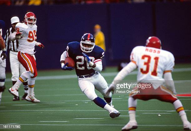 Running back Joe Morris of the New York Giants carries the ball against the Kansas City Chiefs during an NFL football game November 25 1984 at the...