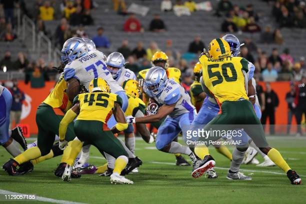 Running back Joel Bouagnon of the Salt Lake Stallions rushes the football against the Arizona Hotshots during the Alliance of American Football game...