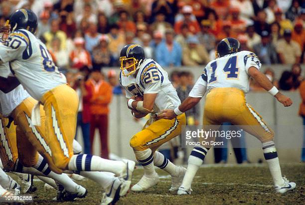 Running Back John Cappelletti of the San Diego Chargers takes the handoff from quarterback Dan Fouts against the Tampa Bay Buccaneers during an NFL...