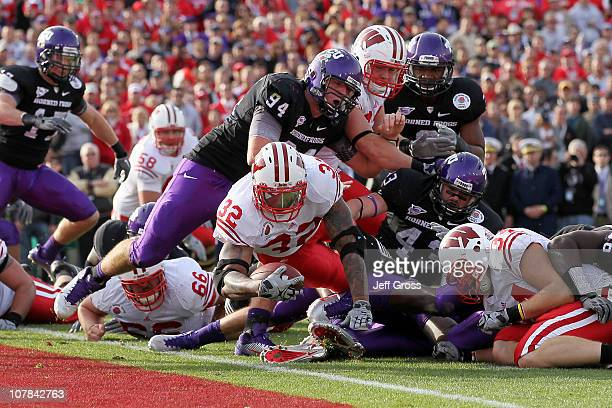 Running back John Clay of the Wisconsin Badgers scores a touchdown in the first quarter against the TCU Horned Frogs during the 97th Rose Bowl game...