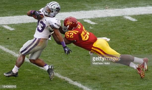 Running back John Hubert of the Kansas State Wildcats is brought down during the second quarter by linebacker Jeremiah George of the Iowa State...