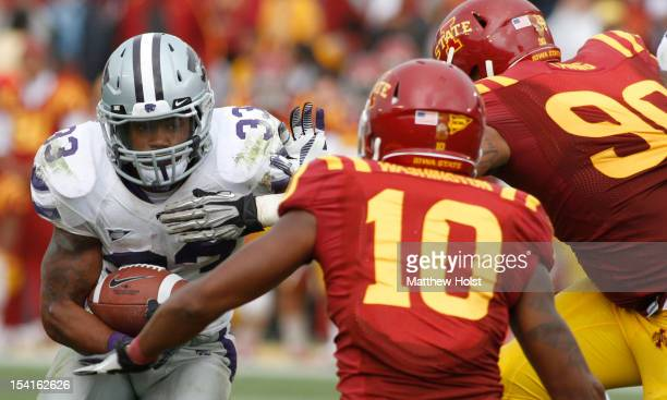 Running back John Hubert of the Kansas State Wildcats runs up the field during the fourth quarter against defensive back Jacques Washington and...