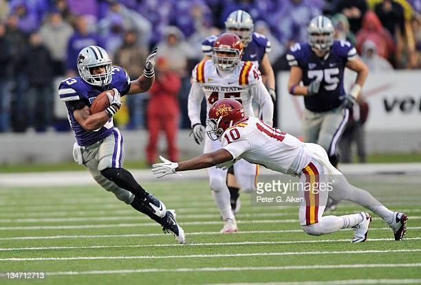 Running back John Hubert of the Kansas State Wildcats rushes for a first down against pressure from free safety Jacques Washington of the Iowa State...