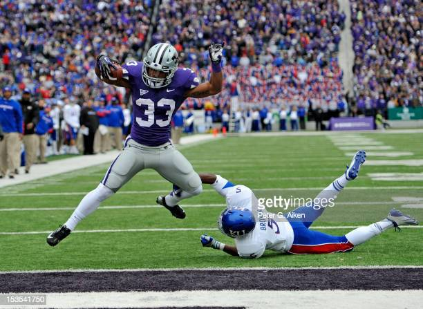 Running back John Hubert of the Kansas State Wildcats rushes past defensive back Greg Brown of the Kansas Jayhawks for a 20-yard touchdown during the...