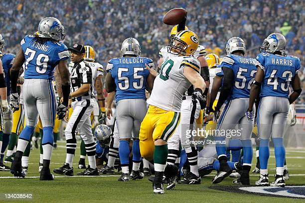 Running back John Kuhn of the Green Bay Packers celebrates his oneyard touchdown run in the third quarter against the Detroit Lions during the...