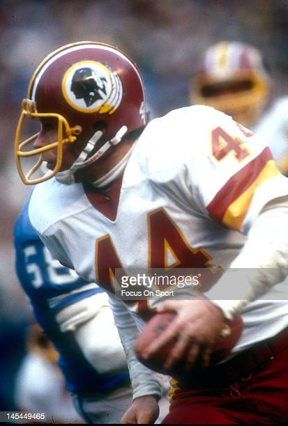 Running back John Riggins of the Washington Redskins carries the ball against the Detroit Lions during an NFL football game November 8 1981 at RFK...