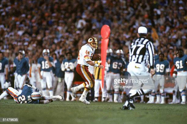 Running back John Riggins of the Washington Redskins rushes for yards during Super Bowl XVII against the Miami Dolphins at the Rose Bowl on January...
