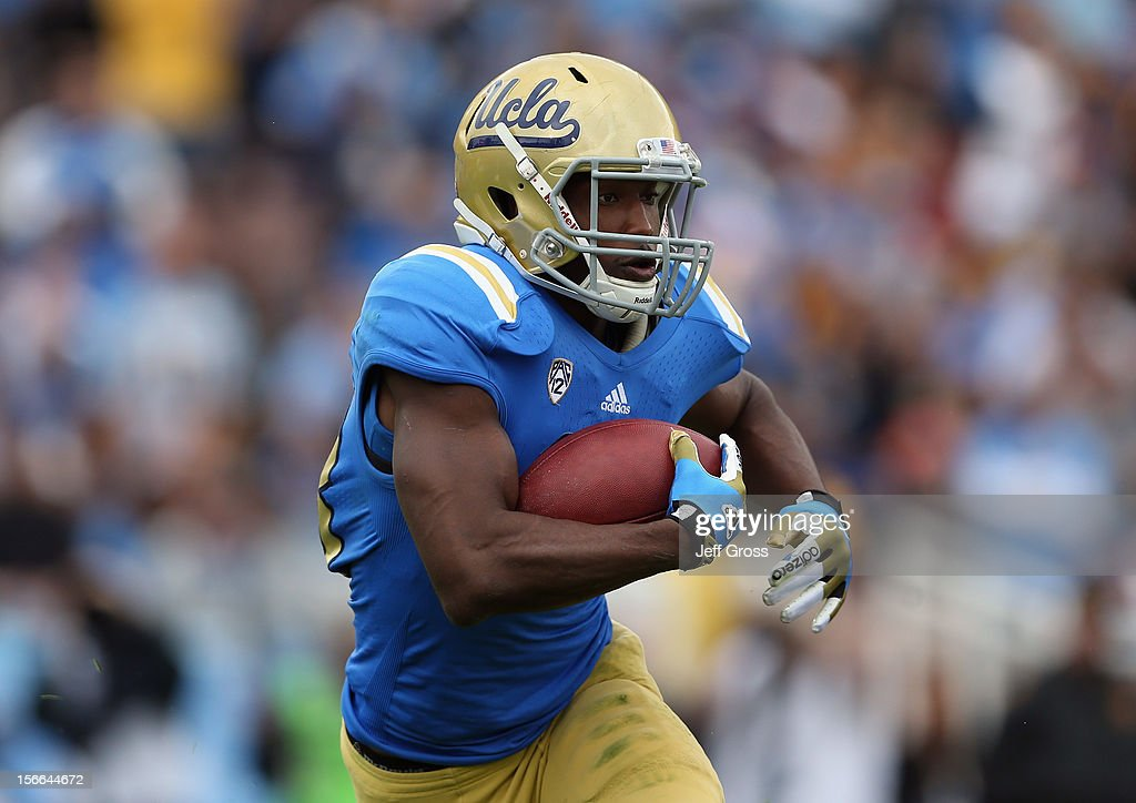 Running back Johnathan Franklin #23 of the UCLA Bruins carries the ball against the USC Trojans in the first half at the Rose Bowl on November 17, 2012 in Pasadena, California. UCLA defeated USC
