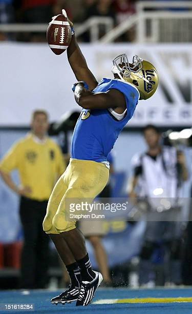 Running back Johnathan Franklin of the UCLA Bruins celebrates after scoring a touchdown on a nine yard pass play in the fourth quarter against the...