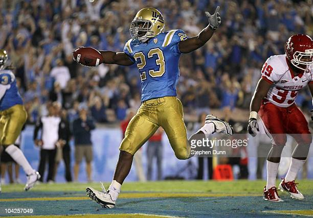 Running back Johnathan Franklin of the UCLA Bruins celebrates as he scores a touchdown against the Houston Cougars in the second quarter at the Rose...