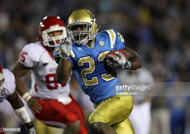 Running back Johnathan Franklin of the UCLA Bruins runs for his third touchdown of the game against the Houston Cougars in the third quarter at the...