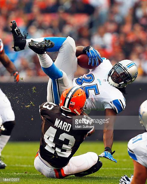 Running back Joique Bell of the Detroit Lions is tackled by defensive back TJ Ward of the Cleveland Browns at FirstEnergy Stadium on October 13 2013...