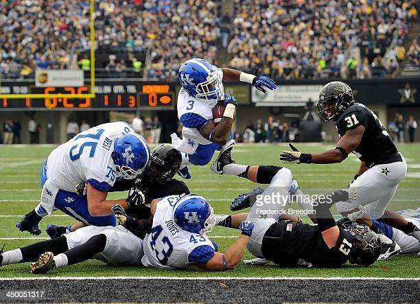 Running back Jojo Kemp of the Kentucky Wildcats dives into the end zone for a touchdown against the Vanderbilt Commodores at Vanderbilt Stadium on...