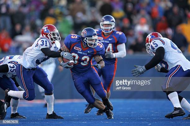 Running back Jon Helmandollar of Boise State carries the ball against strong saftey Bo Cox of Louisiana Tech during the game at Bronco Stadium on...