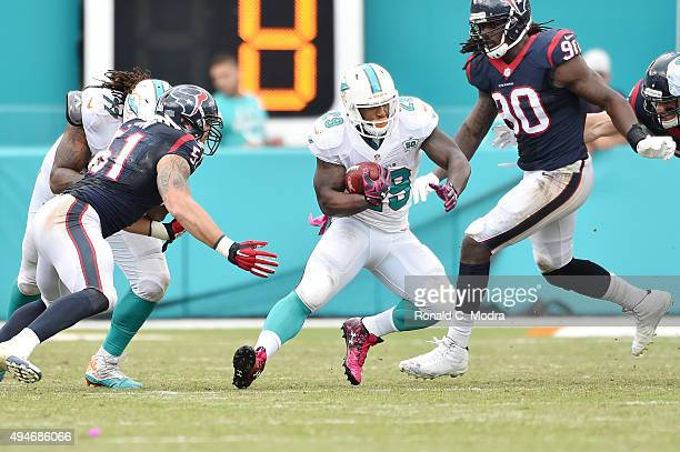 Running back Jonas Gray of the Miami Dolphins carries the ball during a NFL game against the Houston Texans at Sun Life Stadium on October 25 2015 in...
