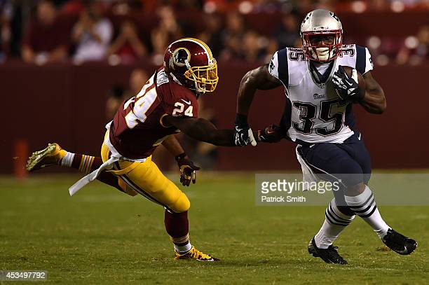 Running back Jonas Gray of the New England Patriots rushes past strong safety Bacarri Rambo of the Washington Redskins during a preseason NFL game at...