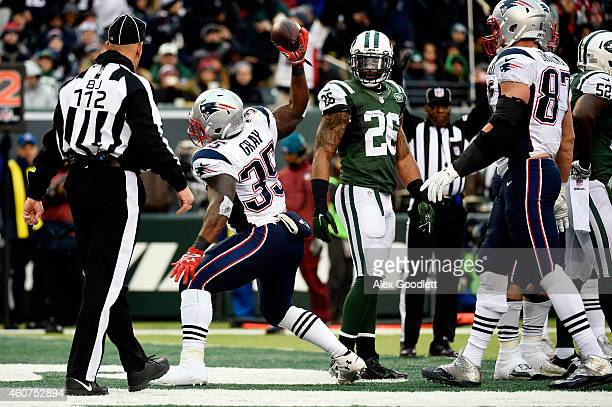 Running back Jonas Gray of the New England Patriots spikes the ball after scoring a touchdown in the fourth quarter against the New York Jets during...