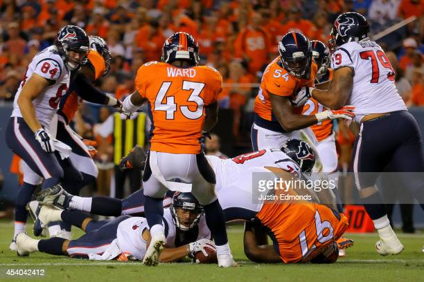 Running back Jonathan Grimes of the Houston Texans pushes across the goal line for a 1-yard touchdown rush in the second quarter against the Denver...