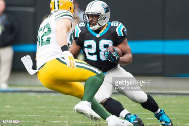 Running back Jonathan Stewart of the Carolina Panthers carries the ball against the Green Bay Packers during a NFL game at Bank of America Stadium on...