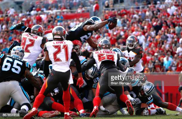 Running back Jonathan Stewart of the Carolina Panthers jumps over the pile on a 1yard rush for a touchdown during the first quarter of an NFL...