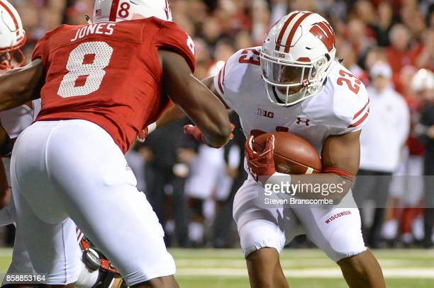 Running back Jonathan Taylor of the Wisconsin Badgers takes on cornerback Chris Jones of the Nebraska Cornhuskers at Memorial Stadium on October 7...