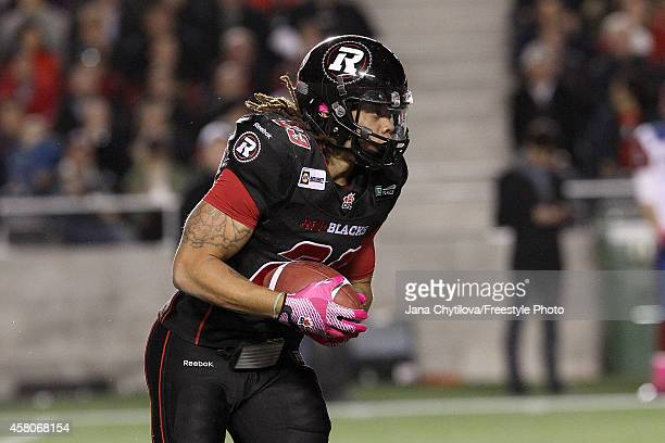 Running back Jonathan Williams of the Ottawa Redblacks runs with the ball against the Montreal Alouettes in the first quarter during a CFL game at TD...