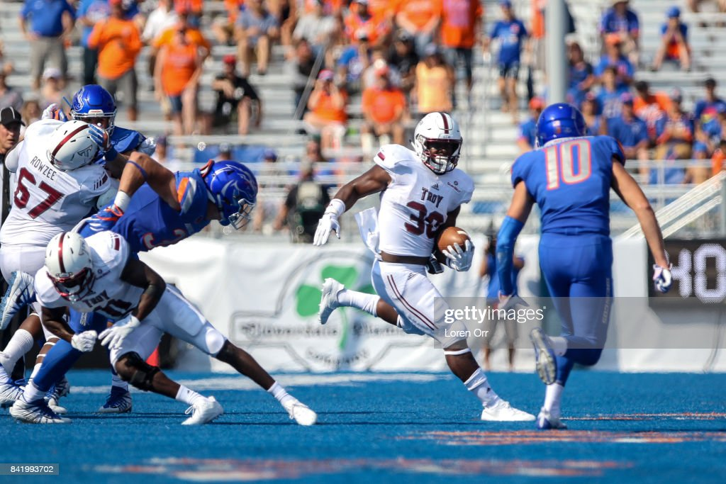 Running back Jordan Chunn #38 of the Troy Trojans looks for a running lane during second half action against the Boise State Broncos on September 2, 2017 at Albertsons Stadium in Boise, Idaho. Boise State won the game 24-13.