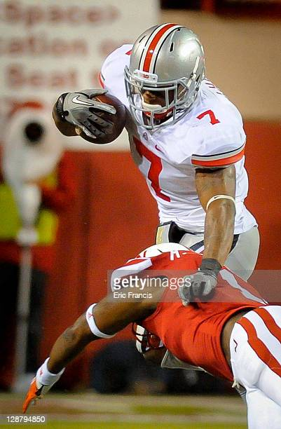 Running back Jordan Hall of the Ohio State Buckeyes leaps over safety Harvey Jackson of the Nebraska Cornhuskers during their game at Memorial...