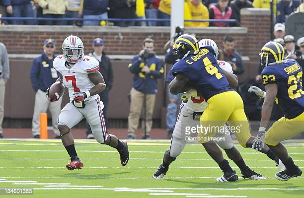 Running back Jordan Hall of the Ohio State Buckeyes runs the ball during a game with the Michigan Wolverines at Michigan Stadium in Ann Arbor...