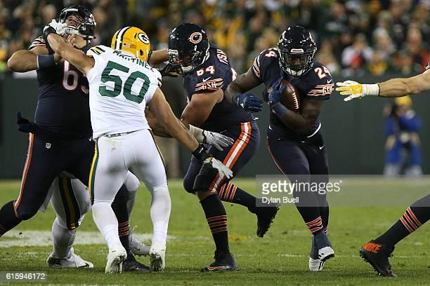 Running back Jordan Howard of the Chicago Bears carries the ball against inside linebacker Blake Martinez of the Green Bay Packers in the second...