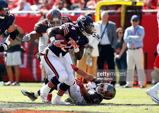 Running back Jordan Howard of the Chicago Bears runs against defensive tackle Akeem Spence of the Tampa Bay Buccaneers and strong safety Chris Conte...