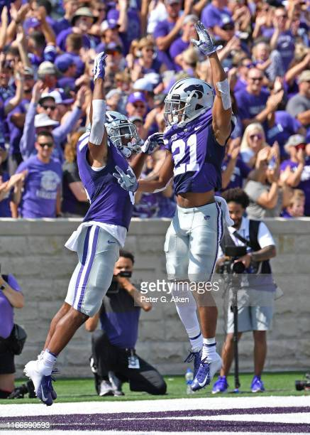 Running back Jordon Brown of the Kansas State Wildcats celebrates wieth wide receiver Wykeen Gill of the Kansas State Wildcats after scoring a...