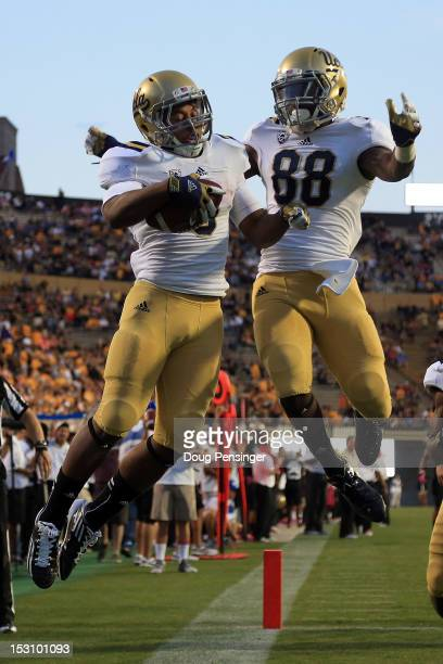 Running back Jordon James of the UCLA Bruins celebrates his 25 yard touchdown run against the Colorado Buffaloes with wide receiver Jerry Rice Jr #88...