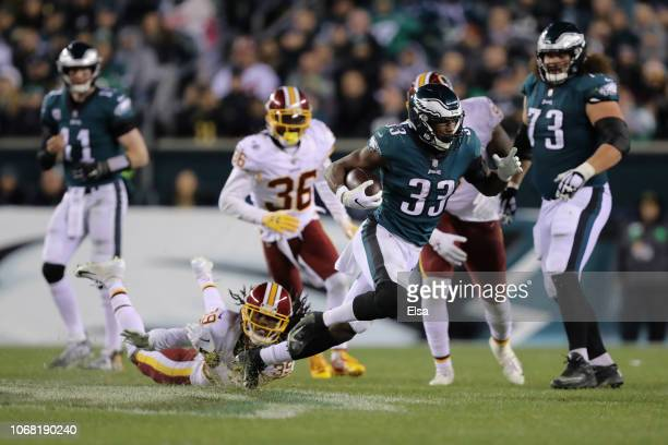 Running back Josh Adams of the Philadelphia Eagles carries the ball against cornerback Adonis Alexander of the Washington Redskins during the fourth...