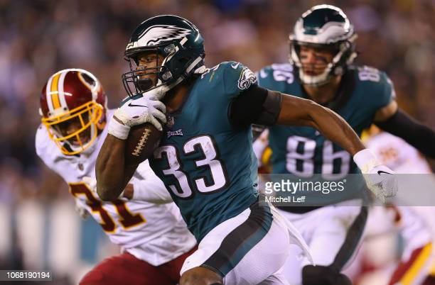 Running back Josh Adams of the Philadelphia Eagles runs the ball against cornerback Fabian Moreau of the Washington Redskins during the third quarter...