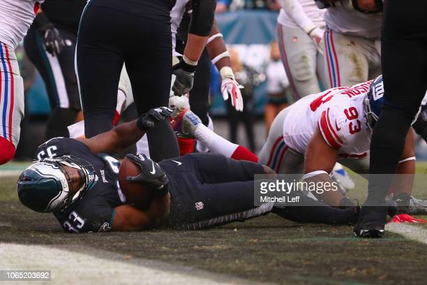 Running back Josh Adams of the Philadelphia Eagles scores a touchdown against the New York Giants during the fourth quarter at Lincoln Financial...