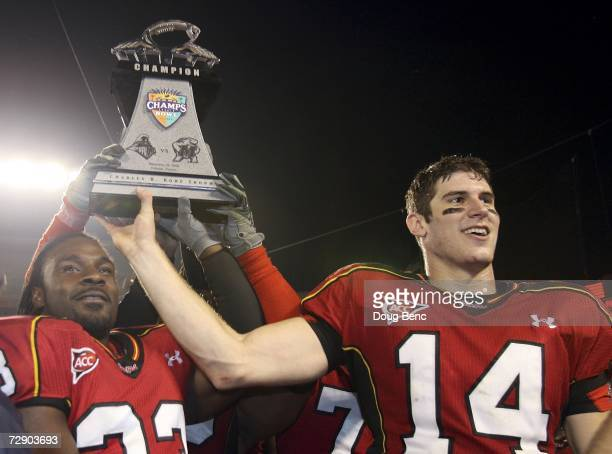 Running back Josh Allen and game MVP, quarterback Sam Hollenbach of the Maryland Terrapins hold the winner's trophy after defeating the Purdue...
