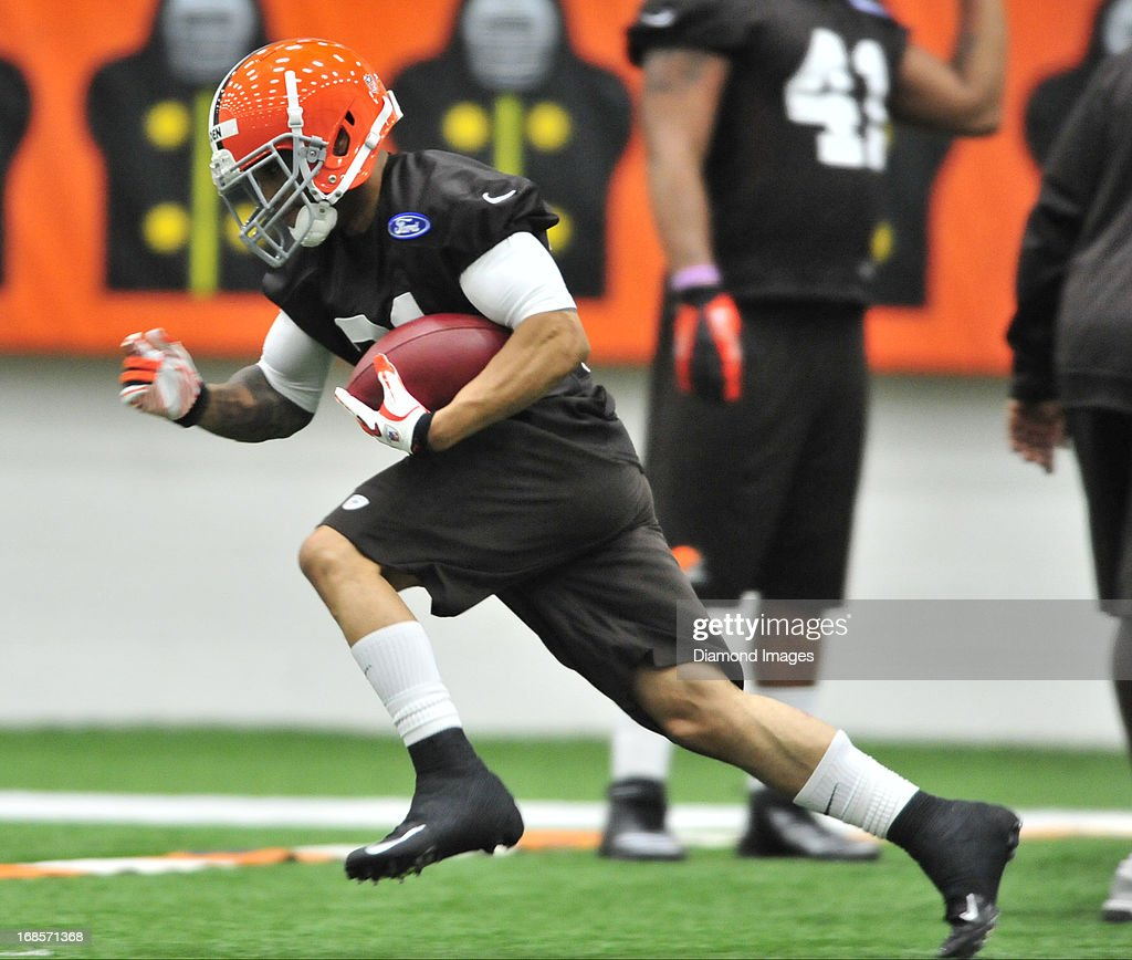 Running back Josh Haden #31 of the Cleveland Browns runs the football during a rookie mini-camp practice on May 11, 2013 at the Cleveland Browns headquarters in Berea, Ohio.