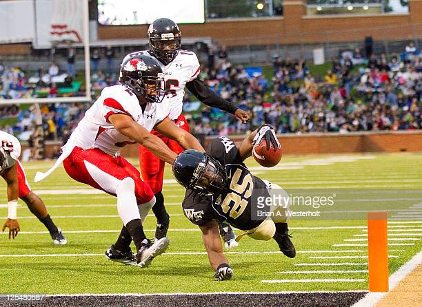 Running back Josh Harris of the Wake Forest Demon Deacons comes up a yard short of the end zone against the GardnerWebb Bulldogs at BBT Field on...