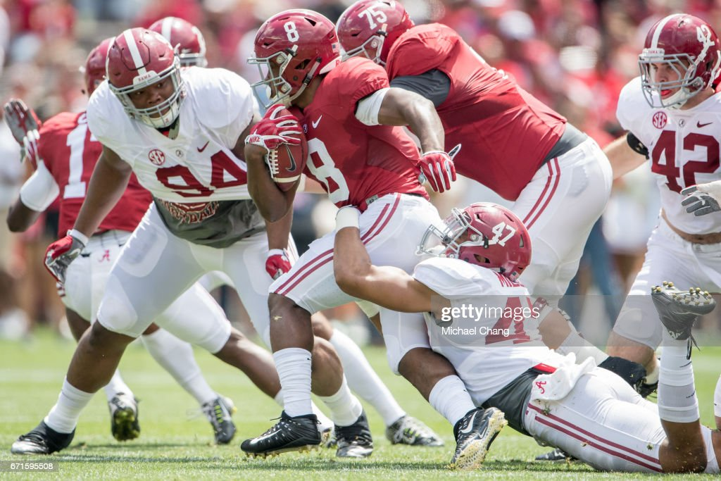 Running back Josh Jacobs #8 of the Alabama Crimson Tide looks to escape a tackle by linebacker Christian Miller #47 of the Alabama Crimson Tide during Alabama's A-Day spring practice game at Bryant-Denny Stadium on April 22, 2017 in Tuscaloosa, Alabama.