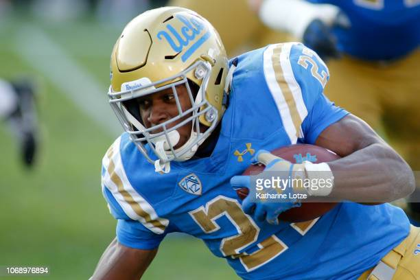 Running back Joshua Kelley of the UCLA Bruins carries the ball down the field during the second half of a football game at Rose Bowl on November 17...
