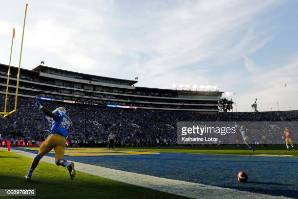 Running back Joshua Kelley of the UCLA Bruins celebrates a touchdown during the second half of a football game at Rose Bowl on November 17 2018 in...
