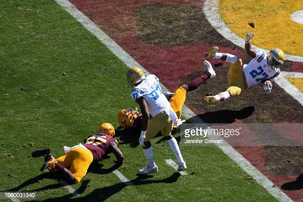 Running back Joshua Kelley of the UCLA Bruins scores a two yard touchdown in the first half against the Arizona State Sun Devils at Sun Devil Stadium...