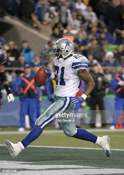 Running back Julius Jones of the Dallas Cowboys runs into the endzone to make the score 19-12 in favor of the Cowboys against the Seattle Seahawks on...