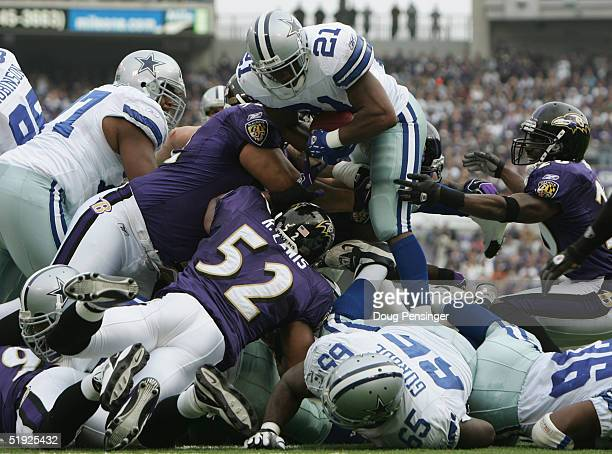 Running back Julius Jones of the Dallas Cowboys tries to jump over linebacker Ray Lewis and the Baltimore Ravens during the game at M&T Bank Stadium...