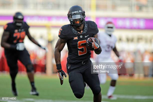 Running back Justice Hill of the Oklahoma State Cowboys breaks away for a touchdown against the Oklahoma Sooners at Boone Pickens Stadium on November...