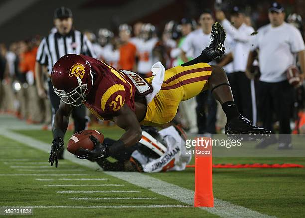 Running back Justin Davis of the USC Trojans falls across the goal line for a touch down in the second quarter against the Oregon State Beavers at...