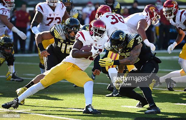 Running back Justin Davis of the USC Trojans is tackled by linebacker Danny Mattingly and linebacker Tyson Coleman of the Oregon Ducks during the...